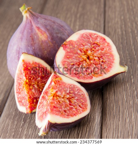 Fresh ripe figs on wooden background, food photo - stock photo