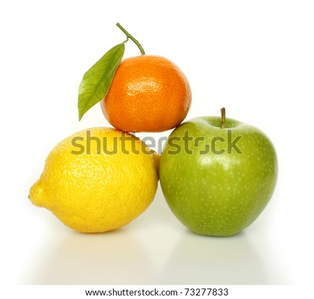 Fresh ripe fruits tangerine, lemon, apple on white background