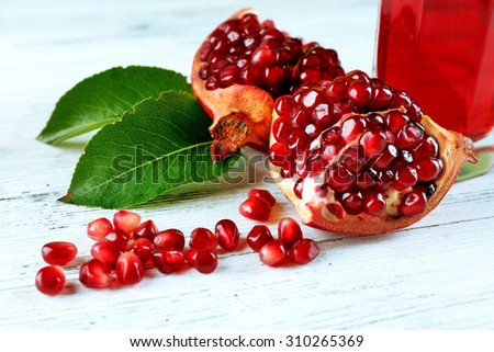 Fresh ripe garnet on wooden table close up - stock photo