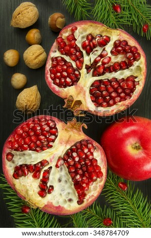 Fresh ripe garnet on wooden table. Top view. Christmas concept. - stock photo