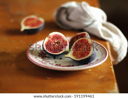 Fresh ripe juicy figs on a dessert plate, selective focus - stock photo