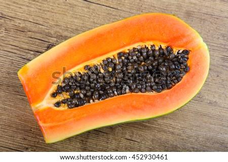 Fresh ripe juicy Slice papaya on wood bakcground - stock photo