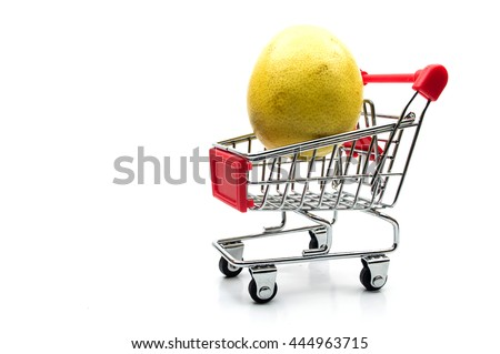 Fresh ripe lemons in a shopping trolley on isolated white background. - stock photo