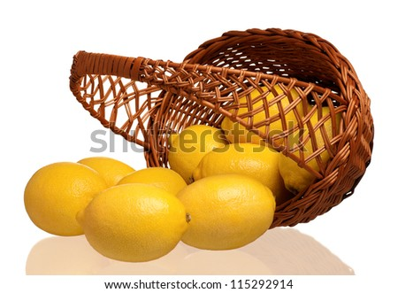 Fresh ripe lemons in wicker basket isolated on white background