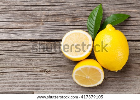 Fresh ripe lemons on wooden table. Top view with copy space - stock photo