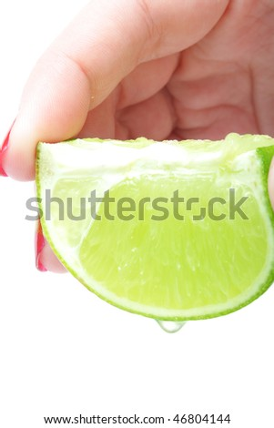 fresh ripe lime in hand on white background (isolated) - stock photo