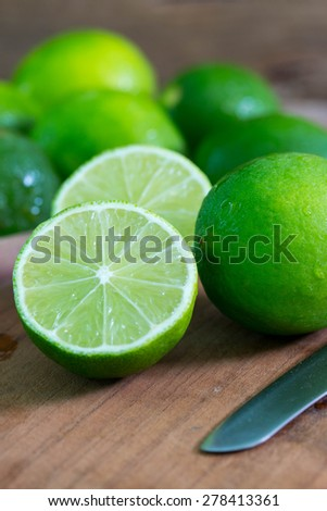 Fresh ripe lime on wooden background - stock photo