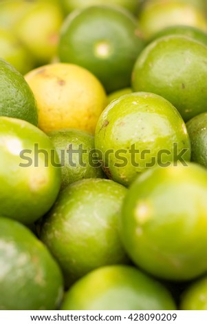 Fresh ripe limes as background - stock photo