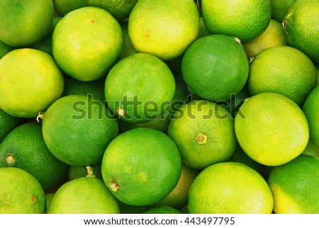 Fresh ripe limes as background