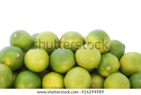 Fresh ripe limes isolated on white background with room for text - stock photo