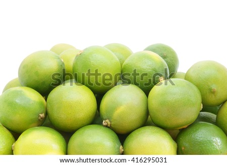 Fresh ripe limes isolated on white background with room for text