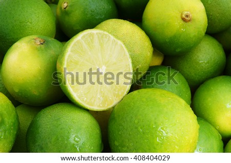 Fresh ripe limes with water drops, lime citrus fruit close up - stock photo