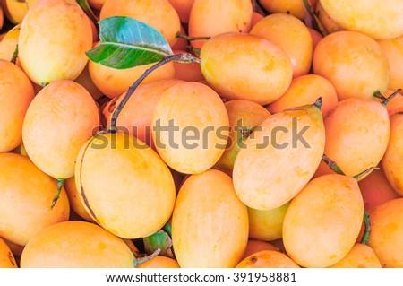 Fresh ripe Marian Plum background, Asian fruit. - stock photo