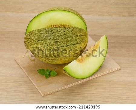 Fresh ripe melon sliced on the desk - stock photo