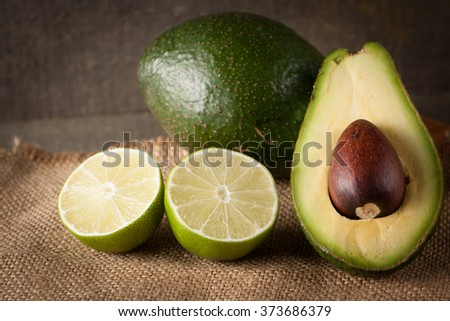 Fresh, ripe, organic avocado on wooden rustic background. Healthy food concept.