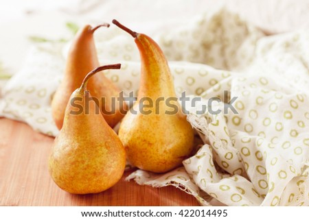 Fresh ripe organic pears on a rustic wooden table, selective focus close up - stock photo