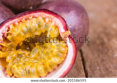 fresh ripe passion fruit on a wooden background - stock photo