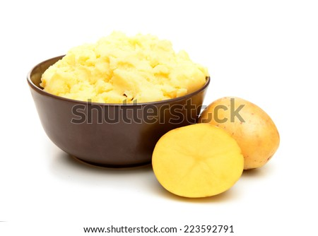 fresh ripe potatoes on white background and a bowl of mashed potatoes - stock photo