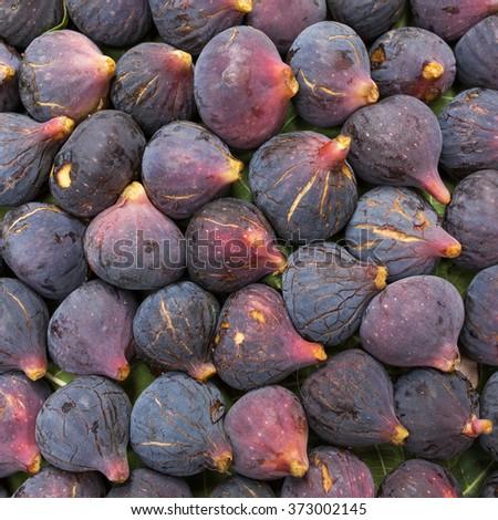 Fresh ripe purple (Black Mission) figs closeup background - stock photo