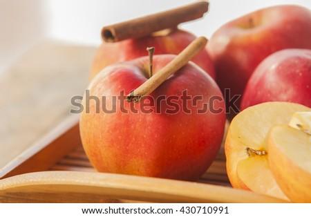 Fresh ripe red apples and cinnamon sticks - stock photo