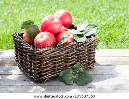 Fresh ripe red apples in basket - stock photo