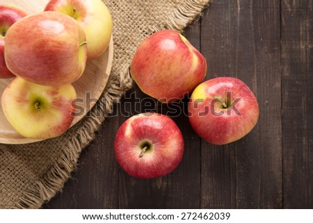 Fresh ripe red apples on wooden background. - stock photo