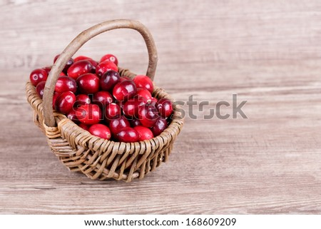 Fresh, ripe, red cranberries on a wooden background
