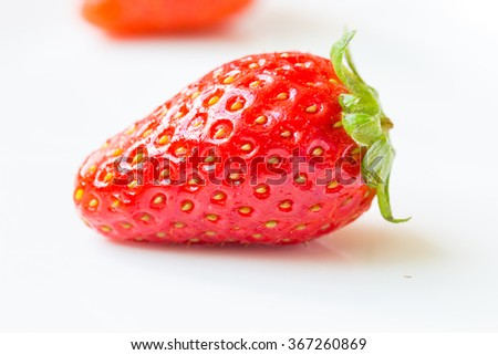 fresh ripe red strawberries in white plate