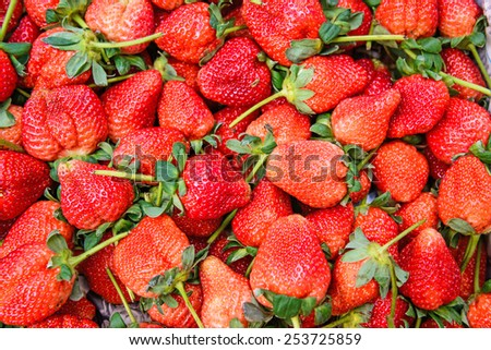 Fresh ripe red strawberries wallpaper. - stock photo