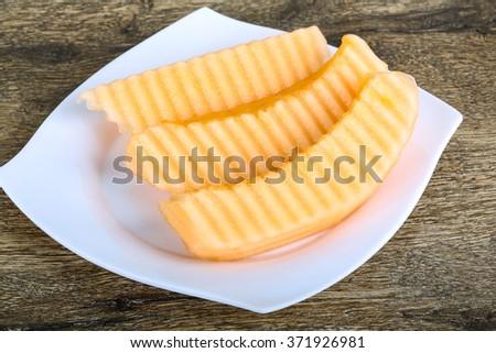 Fresh ripe Sliced melon on the wood background - stock photo