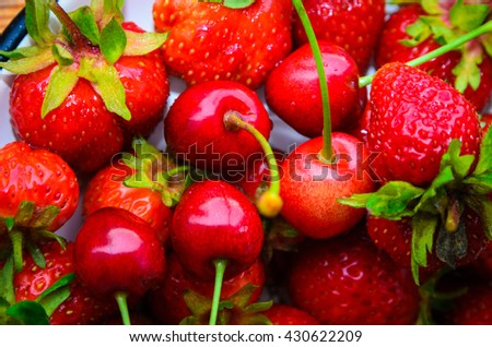 Fresh ripe strawberries and cherry background - stock photo