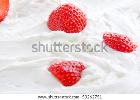 Fresh ripe strawberry halves in tasty curd - stock photo