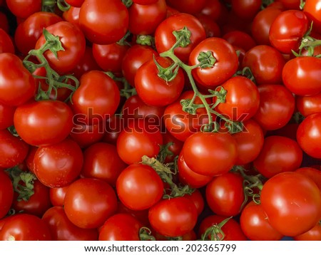 Fresh ripe tomatoes on a market stall