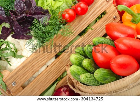 Fresh ripe vegetables in a wooden box.