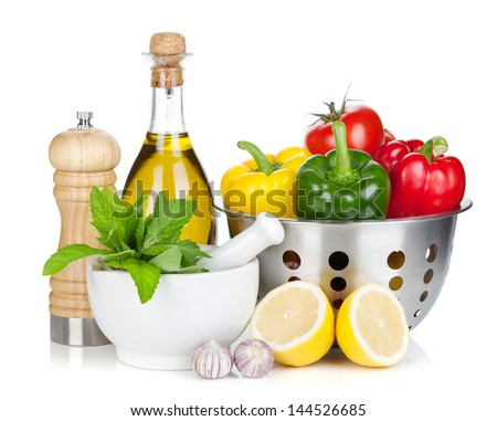 Fresh ripe vegetables in colander, herbs and condiments. Isolated on white background - stock photo