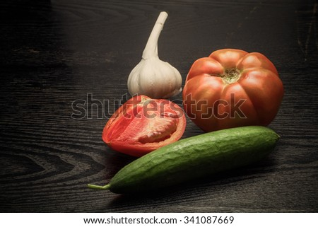 Fresh ripe vegetables on a black table or board like background. Toned. - stock photo