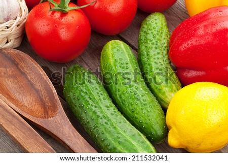 Fresh ripe vegetables on wooden table - stock photo