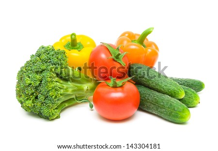 Fresh ripe vegetables. tomatoes, broccoli, peppers and cucumbers isolated on white background close-up. - stock photo