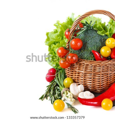 Fresh ripe vegetables with water drops in a basket. - stock photo