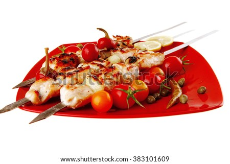 fresh roast chicken shish kebab on red platter - stock photo