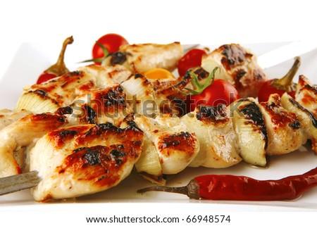 fresh roast chicken shish kebab on white platter - stock photo
