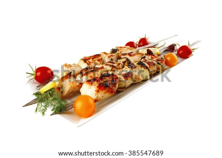 fresh roast shish kebab on white platter