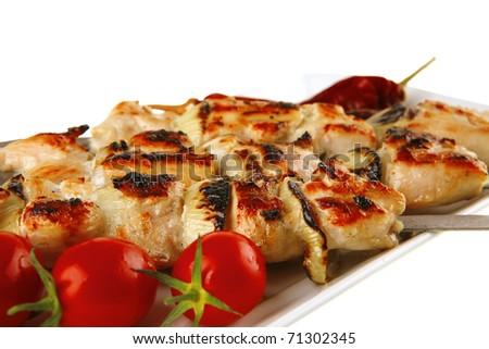 fresh roast shish kebab on white platter - stock photo