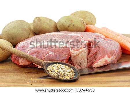 Fresh roast with seasonings potatoes and carrots. Copy space included. - stock photo