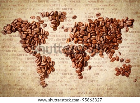 Fresh roasted coffee beans arranged in the shape of a world map on aged vintage paper with the word coffee in multiple languages.