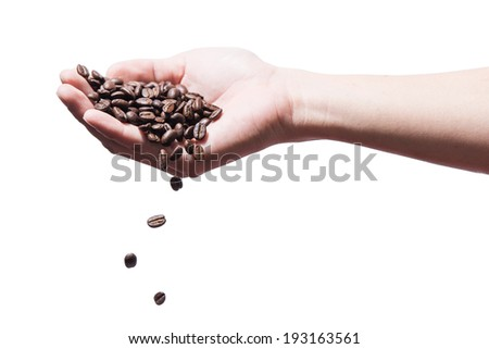 Fresh roasted coffee beans pouring, isolated on white - stock photo