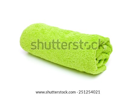 fresh rolled green towel isolated on white background - stock photo