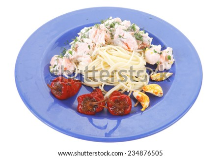 fresh rose wild salmon baked in cream cheese sauce with italian pasta and red hot pepper on blue plate isolated over white background - stock photo