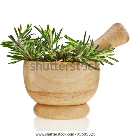 Fresh rosemary herb in wooden mortar with pestle  isolated on white background - stock photo
