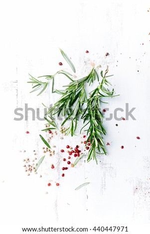 Fresh Rosemary with Pink Peppercorns and Himalayan Salt - stock photo